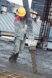 Builder worker pouring concrete Stock Photo