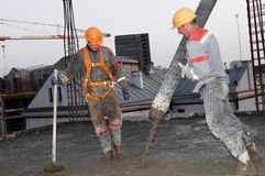 Builder worker pouring concrete Royalty Free Stock Photography