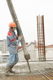 Builder worker pouring concrete Stock Image