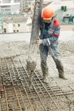 Builder worker pouring concrete Stock Photography