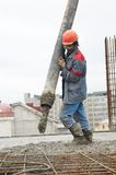 Builder worker pouring concrete Royalty Free Stock Image