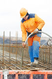Builder worker pouring concrete Royalty Free Stock Photo