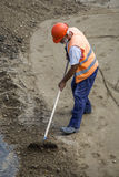 Builder worker with rake leveling Stock Photo