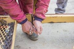 Builder worker tightening the screws Stock Photo