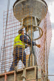 Builder worker using concrete funnel Royalty Free Stock Images