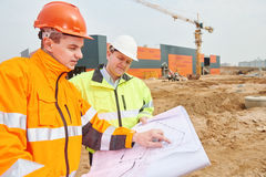 Builder workers at construction site royalty free stock image