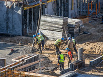 Builder workers pouring concrete royalty free stock photo