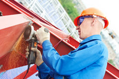 Builder working with angle grinding machine royalty free stock images