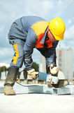 Builder working with cutting grinder stock image