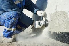 Builder working with cutting grinder Royalty Free Stock Image