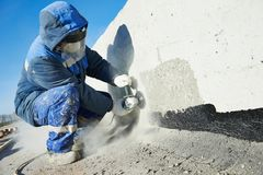 Builder working with cutting grinder Royalty Free Stock Photo