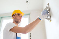 Builder working with grinding tool indoors Stock Images