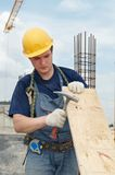 Builder working with hammer Royalty Free Stock Photo