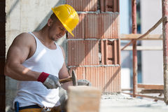 Builder Working With Hammer And Nail Royalty Free Stock Images