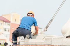 Builder working on residental house construction Royalty Free Stock Photo