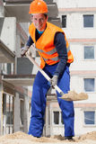 Builder working with a spade Stock Photography