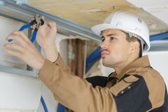 Builder working in suspended ceilings. Builder royalty free stock photos