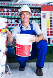 Builder workman in household store Stock Photo