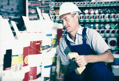 Builder workman in household store Stock Photography