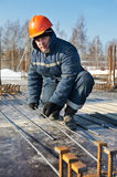 Builder works with concrete reinforcement Stock Photography