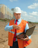 Builder works at construction site Royalty Free Stock Image