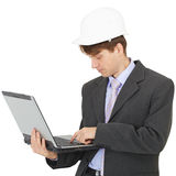 Builder works with laptop holding it on hands Stock Image