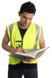Builder writing in a book Royalty Free Stock Photo