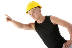Builder in yellow helmet pointing up. Stock Image