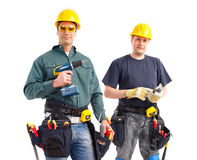 Builders. Smiling builders. Isolated over white background Royalty Free Stock Images