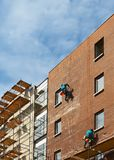 Builders. On a wall of a builded brick building Stock Images