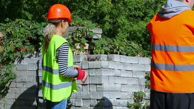 Builders with bricks in the hands stock video footage