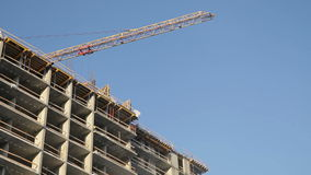 Builders build a house. House under construction, building tower stock footage