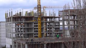 Builders are building a block of flats stock video