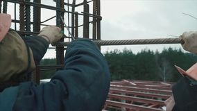 Builders building white brick wall on construction site. Clip. Panorama shot. Builders building white brick wall on construction site. Clip stock footage