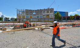 Builders builds a new building in Christchurch New Zealand Royalty Free Stock Image