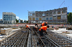 Builders builds a new building in Christchurch New Zealand Royalty Free Stock Images