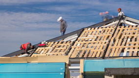 Builders and carpenters working on the roof timelapse stock video