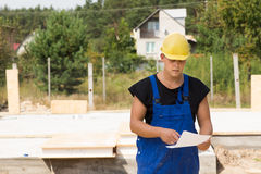 Builders checking specs or an order Royalty Free Stock Image