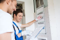 Builders with clipboard and electrical panel Stock Photos