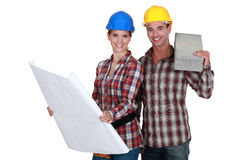 Builders with concrete block. Builders with flat concrete block stock photography