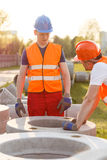 Builders and concrete pipes Royalty Free Stock Image