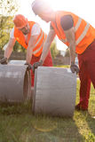 Builders and concrete pipes Stock Image
