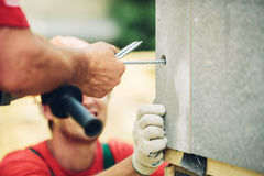 Builders connect large wall screw electric tool Stock Photo
