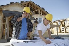 Builders At Construction Site Royalty Free Stock Image