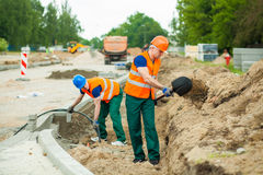 Builders on a construction site Royalty Free Stock Image