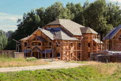 builders cover the roof of log house Stock Images