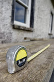 Builders diy tape measure at building site Stock Photography