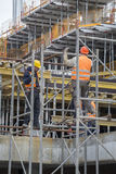 Builders erecting steel scaffold Stock Photo