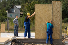 Builders erecting wall panels Stock Photo