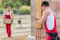Builders during hard physical work Royalty Free Stock Photography